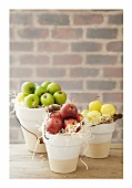Various types of apples in buckets