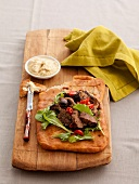 Roast Moroccan-style lamb with salad, hummus and flatbread
