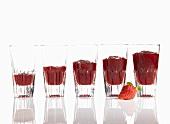 A diagram made of glasses of strawberry jam