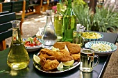 Fried chicken, salad and wine at a Heuriger (seasonal vineyard-run wine bar) in Vienna