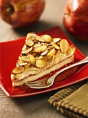 A piece of apple tart with almonds