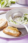 Spring onion soup with radish leaves and warm cheesey bread