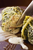 Savoy cabbage roulade filled with chestnuts and ricotta