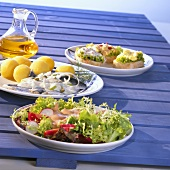 Salad, fish and open sandwiches with rapeseed oil