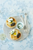 Quail's egg brioche with caviar and sour cream