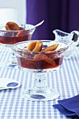 Plum compote in glass bowls