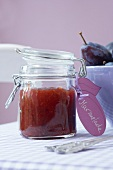 Plum jam in a preserving jar with a label