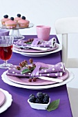 A table laid with blackberries