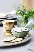 A herb dip with crackers