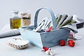 A basket of cutlery and napkins