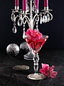 Champagne cocktail with hibiscus flowers