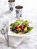 Mixed leaf salad with nectarines and sprouts