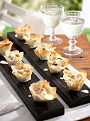 Puff pastry cases filled with salmon, capers and dill