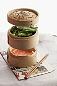 Salmon and spinach in bamboo baskets