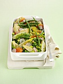Spring vegetables in a baking dish