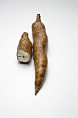 One whole cassava root and half of a root