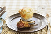 Lamb chops with potato and goat's cheese soufflé