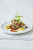 Tuna tartare with cucumber, apple and teriyaki sauce