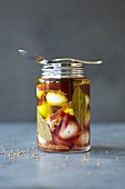 Pickled quails' eggs in a jar