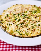 Herb omelette with pine nuts