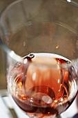 Glass of rosé wine (close-up)