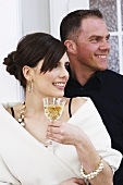 Couple drinking champagne at a stand-up reception