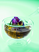 Olive oil flavoured with herbs and edible flowers