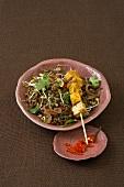 Asian lentil salad with marinated tofu skewer