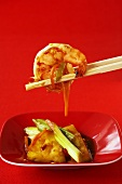 Asian sweet and spicy prawns with chopsticks