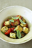 Fried tofu cubes with tomatoes and basil