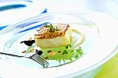 Cod fillet with potato crust on cauliflower cream
