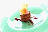 Chocolate cake, raspberry sorbet, raspberry sauce & caramel strands