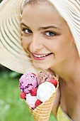 Woman in straw hat holding ice cream cone
