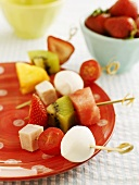 Fruit, tomatoes and mozzarella on skewers