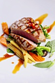 Marinated, grilled tuna on Asian vegetables