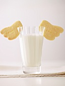 Glass of milk and shortbread with the word Enjoy