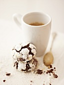 Snow caps (chocolate cookies with icing sugar) with coffee