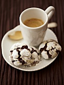 Snow caps (chocolate cookies with icing sugar) and espresso