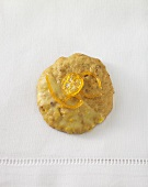 An orange marzipan biscuit