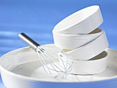 Porcelain dishes and whisk