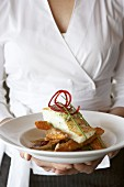 Halibut on deep-fried yam wedges