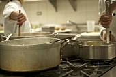 Chefs stirring pans