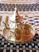 Moroccan mint tea in teapot and glasses