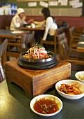 Dolsot Bibimbap (Rice, vegetables & meat in stone bowl, Korea)