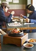 Dolsot bibimbap (Rice, vegetables & meat in stone pot, Korea)