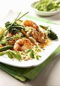Prawn and vegetable stir-fry on rice