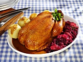 Duck with red cabbage and potato dumplings