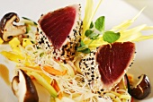 Seared tuna fillets with sesame seeds on Asian vegetables