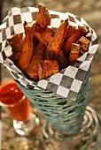 Sweet potato chips in paper napkin