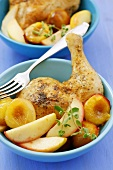 Baked chicken leg with apples, plums and marjoram